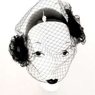 """Secrets"", black organza headpiece with netting and detail"