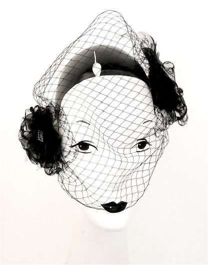 """""""Secrets"""", black organza headpiece with netting and detail"""
