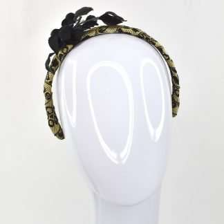 Antique gold and black ribbon with black velvet leaves on black velvet headband
