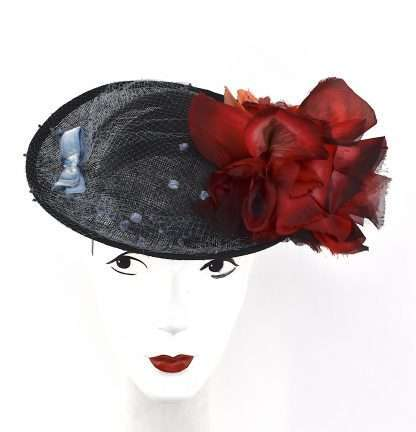 Black saucer hat with large red flower