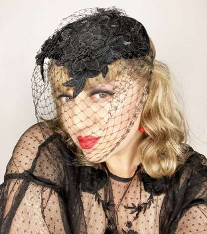 Black wool headpiece with lace and veiling