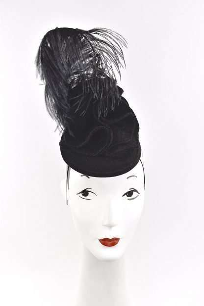 A stunning black wool sculpted headpiece with black feathers to compliment any Fall wardrobe. Classic and modern at the same time. One of a kind and simply lovely for those seeking something unique in cooler weather. Base and headpiece is made of 100% wool. Attaches with hat elastic. This headpiece is a work of art, so wear art!