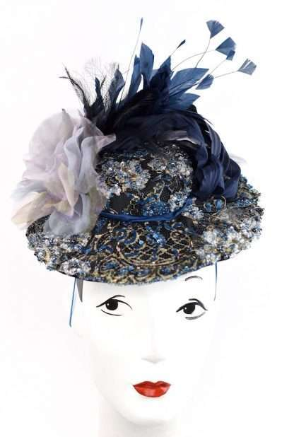 Blue boater style with beading,feathers and silk flowers