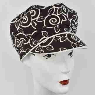 Brown cap with ivory swirls design