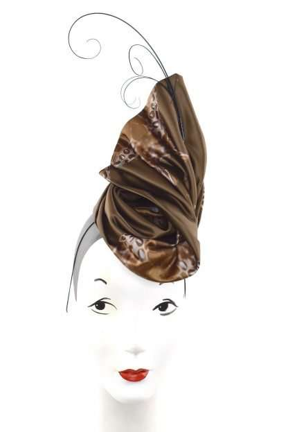 Brown satin headpiece with feathers on base