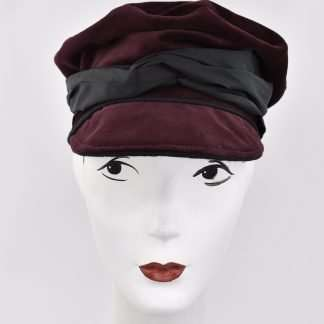 Burgundy velvet cap with black band