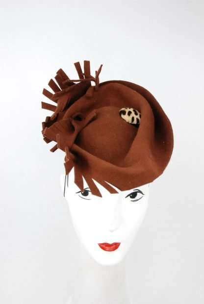 Freeform sculpted wool felt hat with fur button
