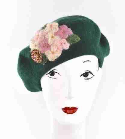 Dark green wool beret with a handmade detail