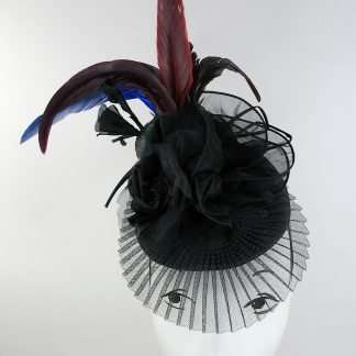 Feathered headpiece with black silk flowers