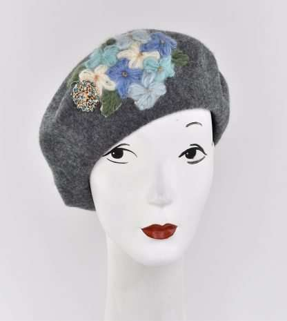 Grey wool beret with a handmade knit flower detail