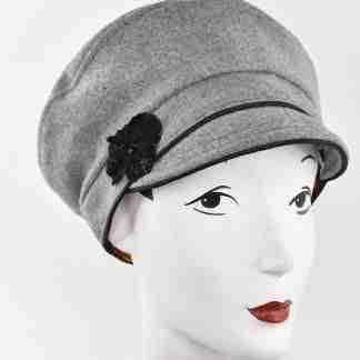 Grey wool cap with black trim and velvet flower