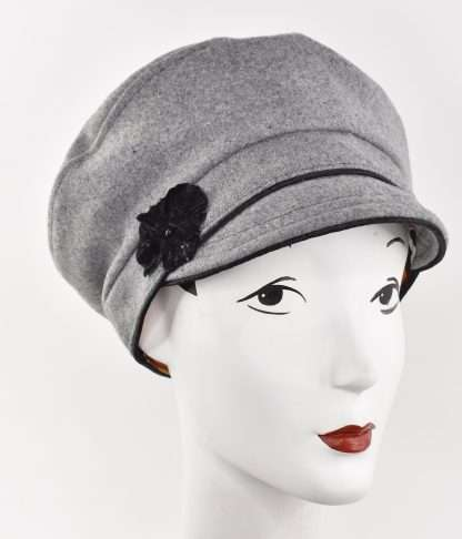 Grey wool cap with black trim and velvet flower