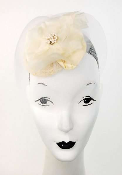 Ivory silk flower with white horsehair ribbon