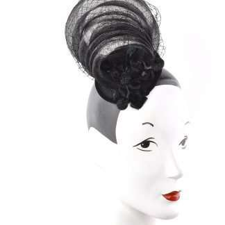 This simple and chic headpiece is a made of horsehair swirls on black wool base. Detailed with black velvet leaves and vintage velvet grapes. Attaches on your head with clip.