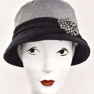 Black and grey bucket hat with black band and brim and check flower