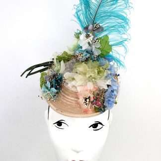 "Kentucky Derby anyone? This ""Birds of a feather"", headpiece is made with vintage flowers and netting"
