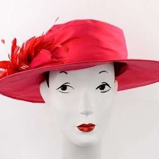 Large brim red silk hat with red feathers