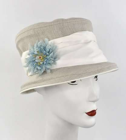 Natural linen bucket hat with white back and blue flower