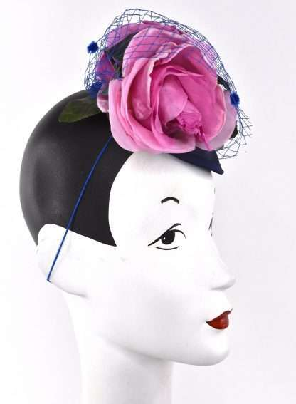 Pink rose headpiece with navy base and blue veiling