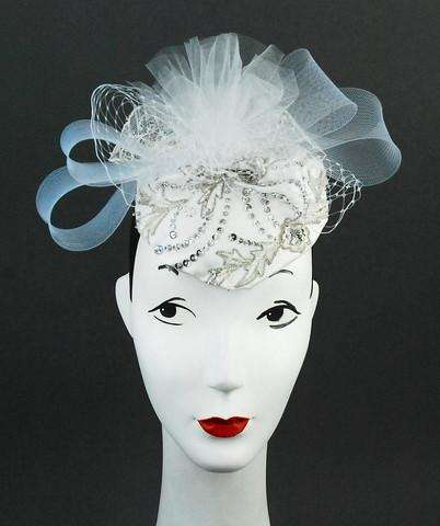 White satin headpiece with tulle and beading