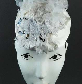 White silk and lace headpiece with vintage white flowers and sequins