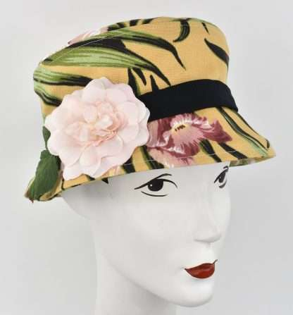Yellow floral print bucket hat with pink flower and black band