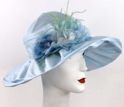 Large brim blue silk hat with feathers and silk vintage flowers