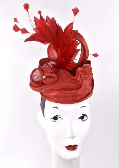 Red sculpted headpiece with red feathers
