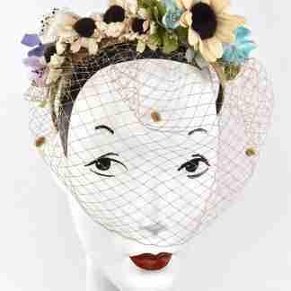 Tan chenille dot veiling headband with velvet daisy flowers